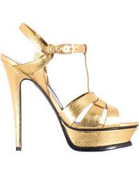 "Saint Laurent Gold Leather Laminated ""Tribute 105"" Shoes - Lyst"