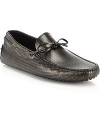 Tod's Gommini Tie-Front Drivers silver - Lyst