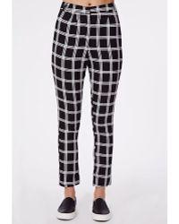 Missguided Alisia Grid Print Tapered Leg Trousers Black - Lyst
