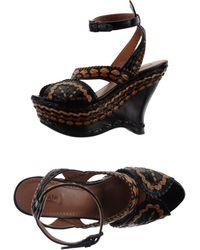 Alaïa Black Sandals - Lyst