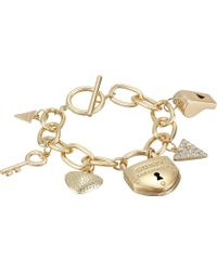 Guess Key, Whistle, Lock Toggle Charm Bracelet - Lyst