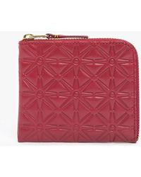 Comme des Garçons Half Zip Star Embossed Wallet red - Lyst