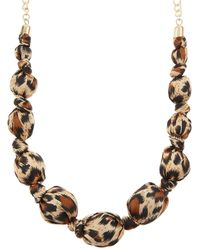 Accessorize - Leopard Wrapped Balls Necklace - Lyst