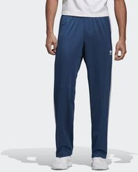 1d242886557 Lyst - adidas Firebird Mens Track Pants in Blue for Men