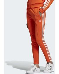 526f621b adidas V-day Sst Track Pants in Red - Lyst