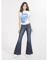 Alice + Olivia - Beautiful Low Rise Bell Jean - Lyst
