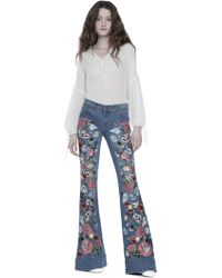 Alice + Olivia - Ryley Embroidered Low Rise Bell Jean - Lyst