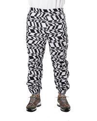 Nike - Nike Nsw Printed Swosh Woven Pant - Lyst