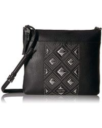 aec3db60bc2f Calvin Klein - Classic Pebble Key Item All-over Pyramid Stud Embellished  Crossbody - Lyst