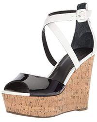 5cfe2395c0d5 Lyst - Guess Karinda 2 Wedge Sandal in Black