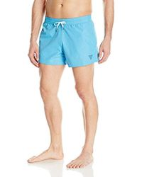 Guess - Solid Reversible 13 Inch Elastic Waist Swim Trunk - Lyst