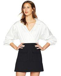 6f5a0201bd Lyst - Fleur du Mal Ruffle Front Silk Bodysuit in Black - Save 27%