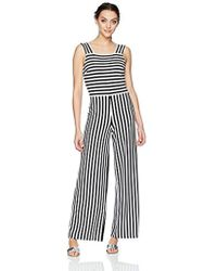 cf4e47b2bee Lyst - Armani Exchange Asymmetrical Popover Jumpsuit in Black