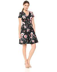 9bdad82d65 Ivanka Trump Sleeveless Floral-print Popover Dress in Black - Lyst