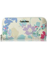 Calvin Klein - Printed Saffiano Zip Around Wallet - Lyst
