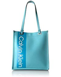 2c59ff9f03 Lyst - Calvin Klein Franzy Clear North/south Tote in Red