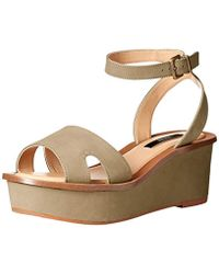 98c5f0737645 Lyst - Tommy Hilfiger Women S Venitia Platform Wedge Sandals in Metallic