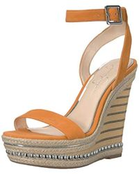 b200ee1c12fc Lyst - Jessica Simpson Alinda Embellished Wedge Sandal in Metallic