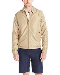 Izod - Golf Jacket With Faux Leather Tabs - Lyst