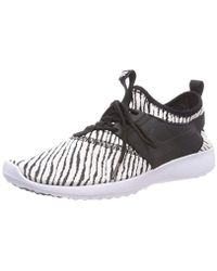311ebfab3b7 Nike Juvenate Women s Trainers in Black - Lyst