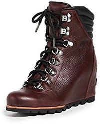 8e78acb9462b Lyst - Sorel Conquest Wedge Holiday Booties