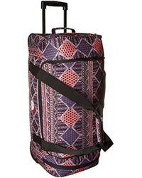 Roxy - Distance Across Wheeled Duffle Bag - Lyst