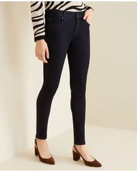 Ann Taylor - Sculpting Pockets Skinny Jeans In Classic Rinse Wash - Lyst