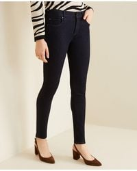 Ann Taylor - Petite Sculpting Pockets Skinny Jeans In Classic Rinse Wash - Lyst
