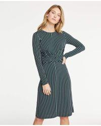 dc573cd5587 Ann Taylor - Petite Striped Matte Jersey Wrap Dress - Lyst