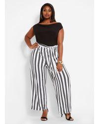 5a68a0c27d37f Ashley Stewart - Plus Size Drape Neck Stripe Jumpsuit - Lyst