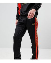Fila - Poly Tricot Joggers With Taping In Black - Lyst
