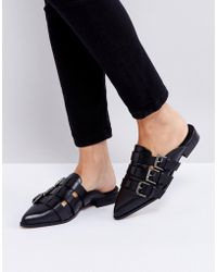 INTENTIONALLY ______ - Parliament Black Buckle Flat Mules - Lyst