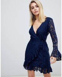 Love Triangle - Lace Wrap Dress With Ruffle Cuff And Hem In Navy - Lyst