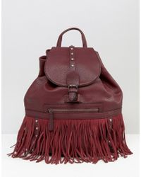 Glamorous - Drawstring Backpack With Stud And Fringe Detail - Lyst