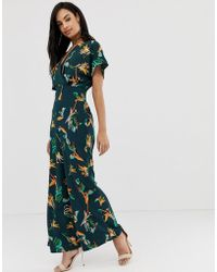 12baef04880 River Island Flute Sleeve Tropical Print Jumpsuit in Pink - Lyst