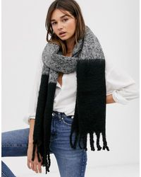 ASOS - Fluffy Two Tone Colour Block Scarf With Tassels In Grey And Black - Lyst