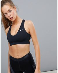 13dd464f3f Nike Training Indy Logo Sports Bra - Lyst
