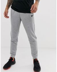 c1b58ea48e95 Nike Tech Knit Joggers In Tapered Fit In Grey 832180-091 in Gray for ...