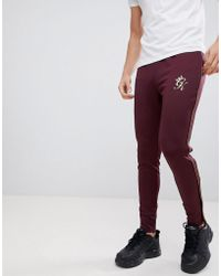 Gym King - Skinny joggers In Burgundy With Gold Piping - Lyst