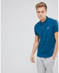 Hollister - Stretch Pique Polo Seagull Logo In Blue - Lyst