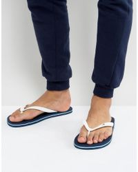 Hollister - Logo Thongs In Navy - Lyst