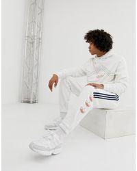 adidas Originals - Pantalon de jogging rayures et logo trfle - Lyst
