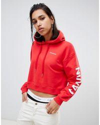c299d448901d Calvin Klein Sudadera con capucha con logo extragrande en las mangas
