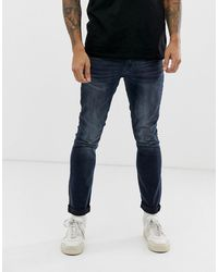 Burton Skinny Jeans In Vintage Dark Wash - Blue