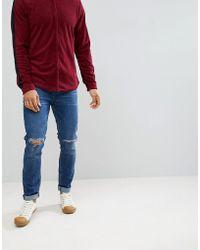 ASOS - Jean skinny dlavage fonc avec dchirures aux genoux - Lyst