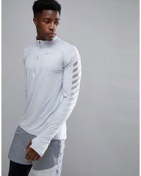 026a10ff0b2d Nike - Flash Element Reflective 1 4 Zip Sweat In Grey 859199-012 -