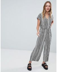 Monki - Stripe Plisse Jumpsuit In Black And White - Lyst