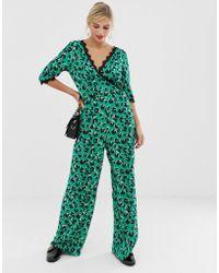 01d36a02ed4 Liquorish - Wrap Front Jumpsuit In Bright Leopard Print With Lace Trim  Sleeve Detail - Lyst