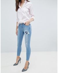 ASOS - Asos Whitby Low Rise Skinny Jeans In Mid Wash Blue With Rip And Repair - Lyst
