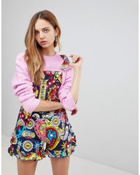 Love Moschino | Surprises Printed Playsuit | Lyst